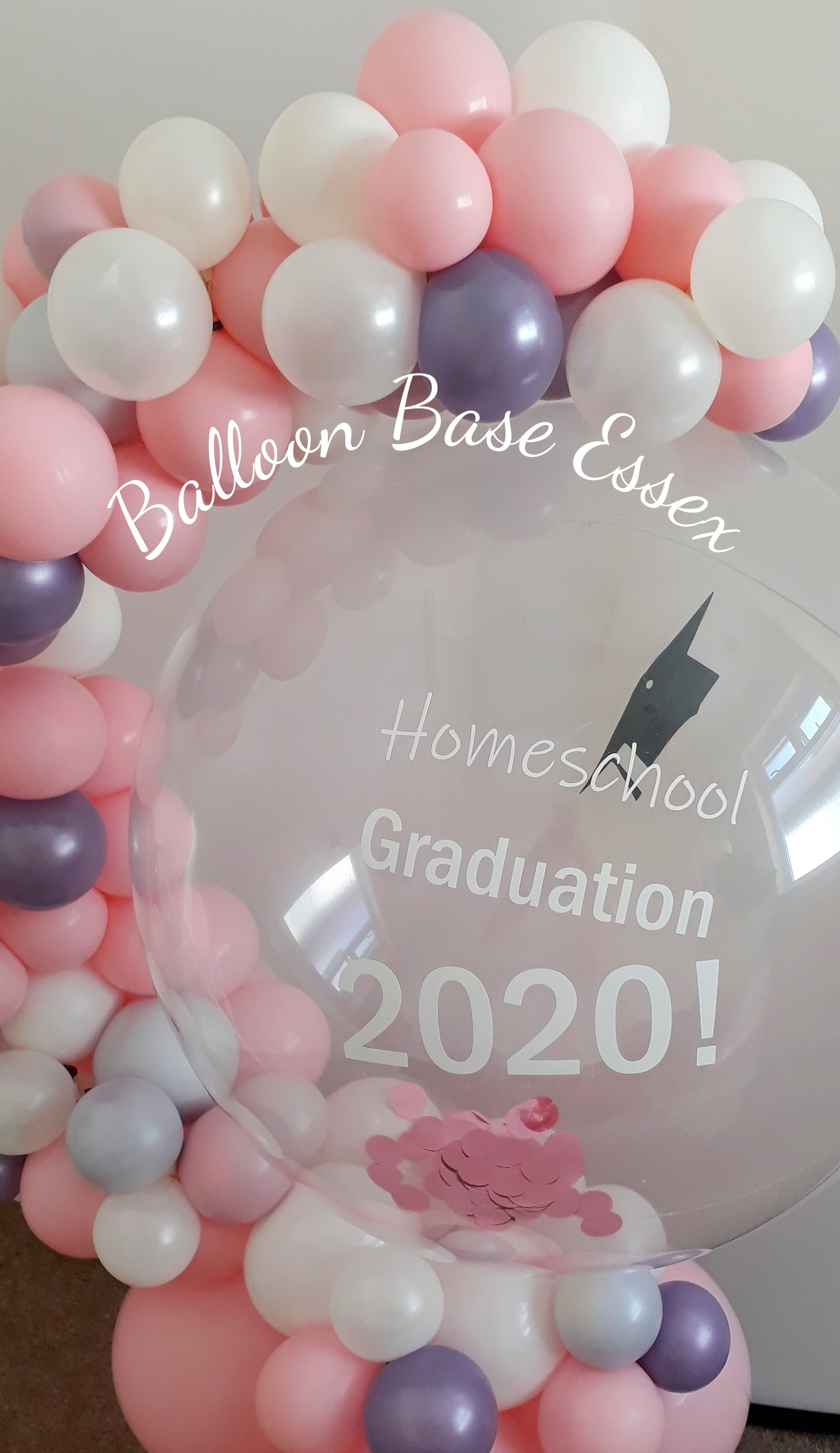 Clear balloon with white writing and garland
