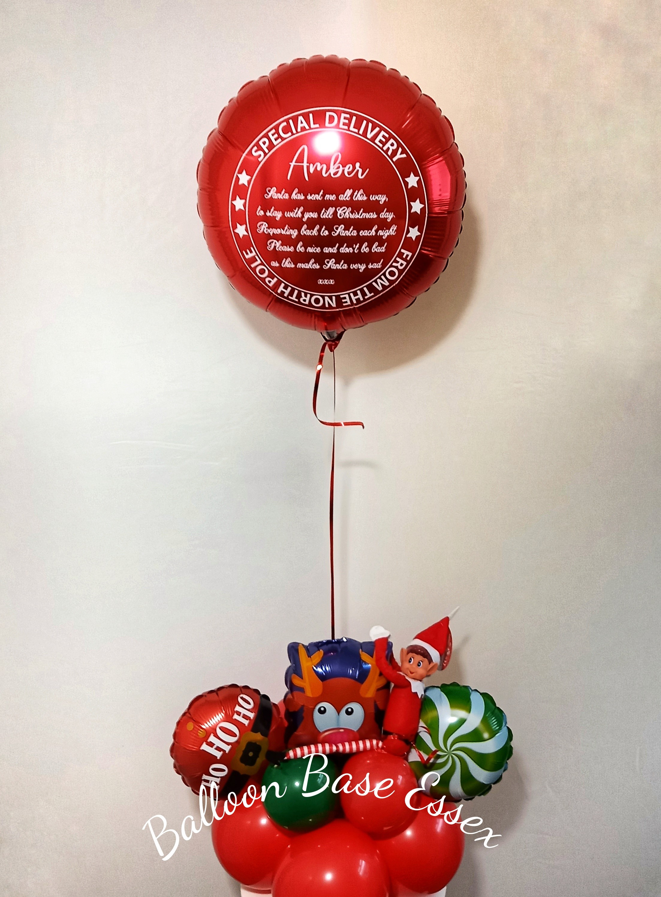 Red balloon with elf toy