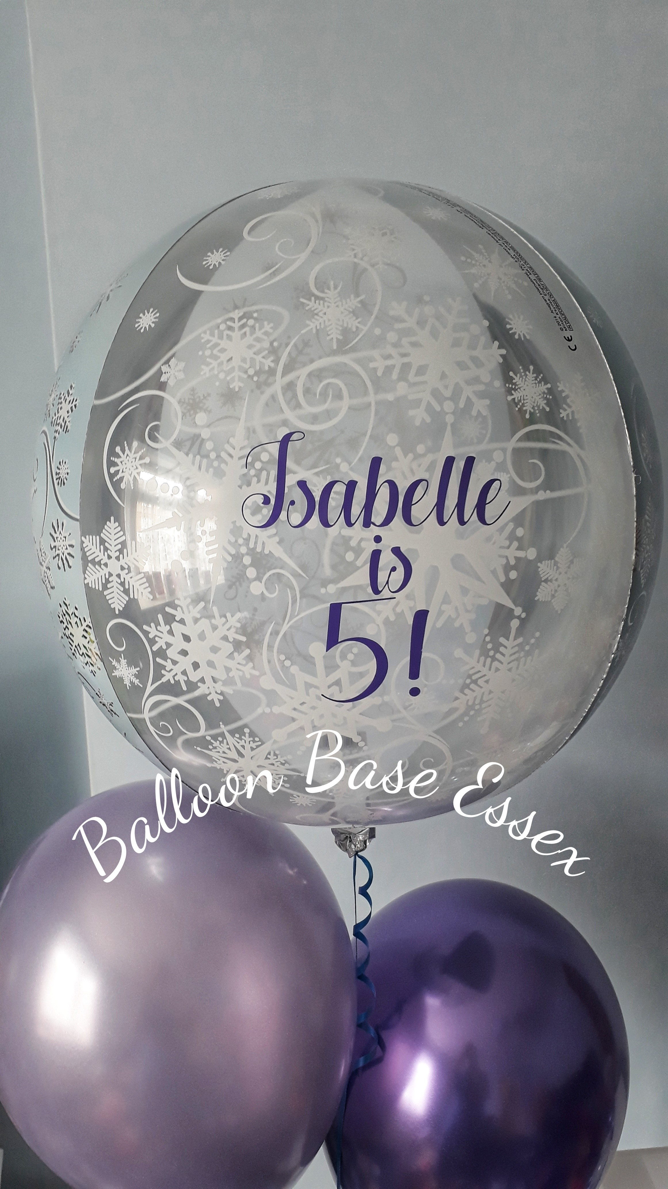 Snowflake balloons with purple writing
