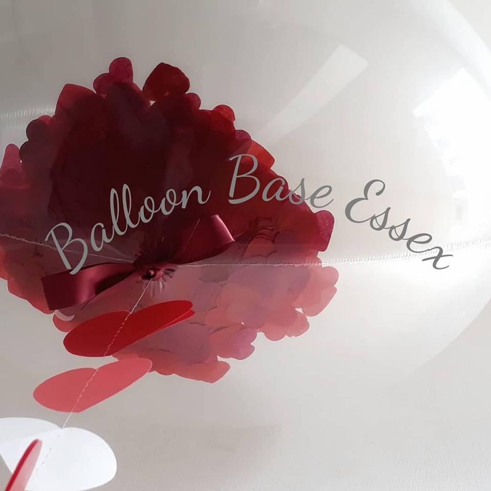 Clear balloon with red confetti