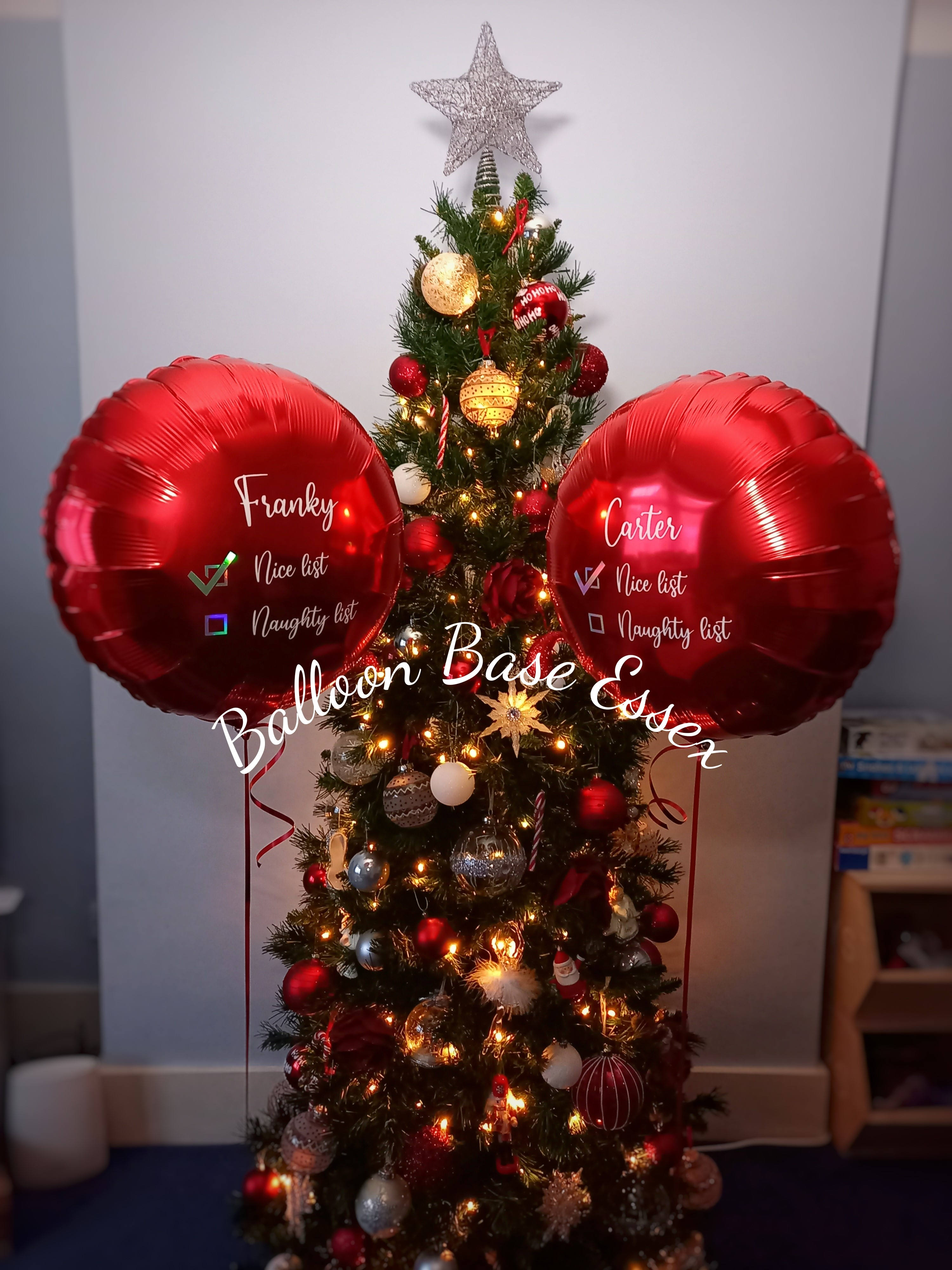 two Christmas balloons with writing