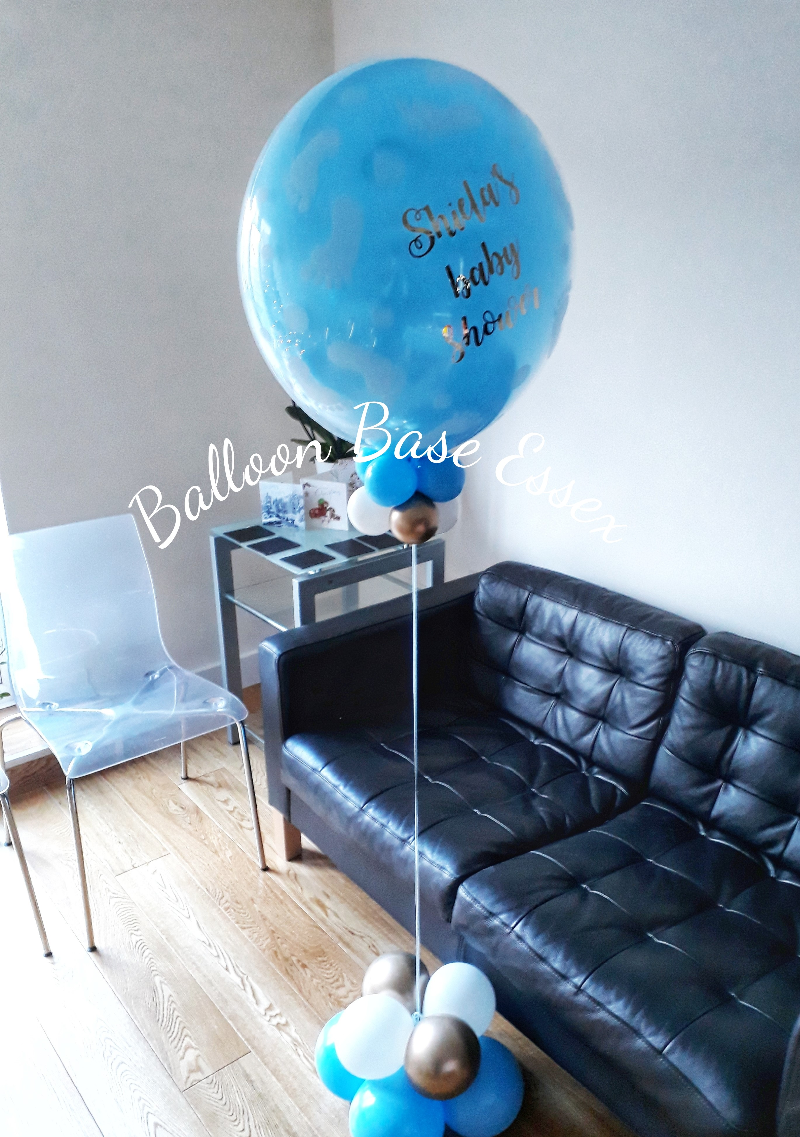 Blue baby shower balloon in room