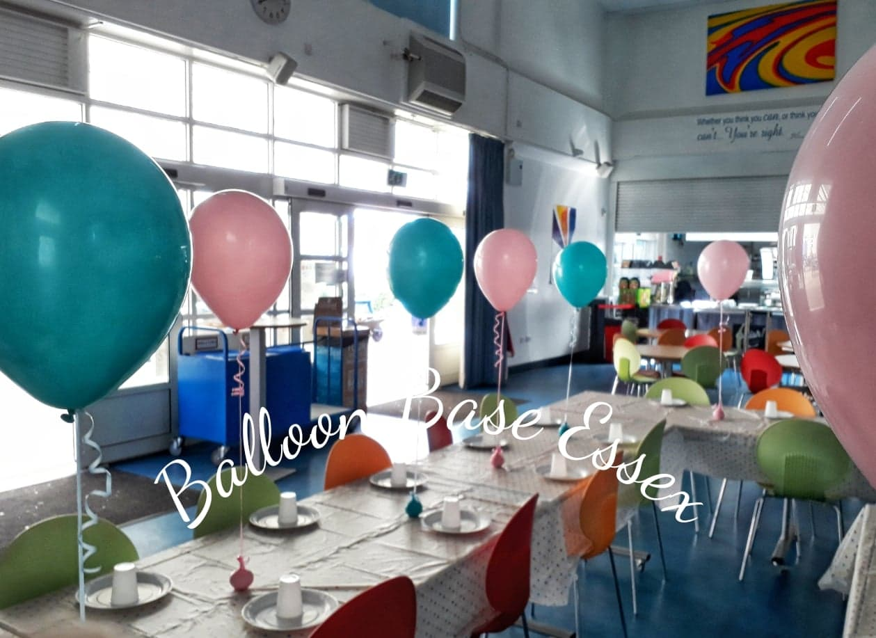 Pink and blue balloons at child's birthday party