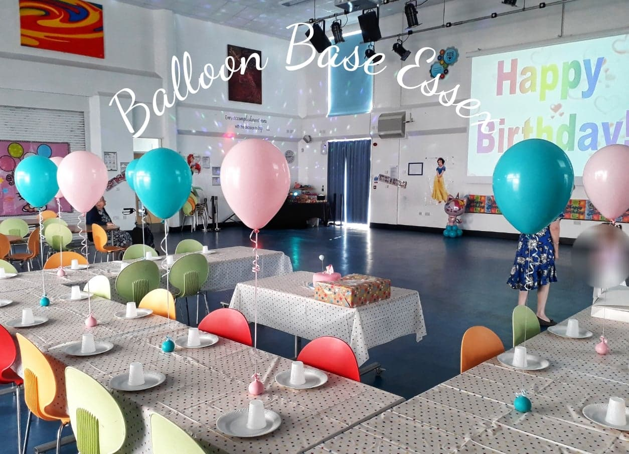 Balloons decorating tables at birthday party