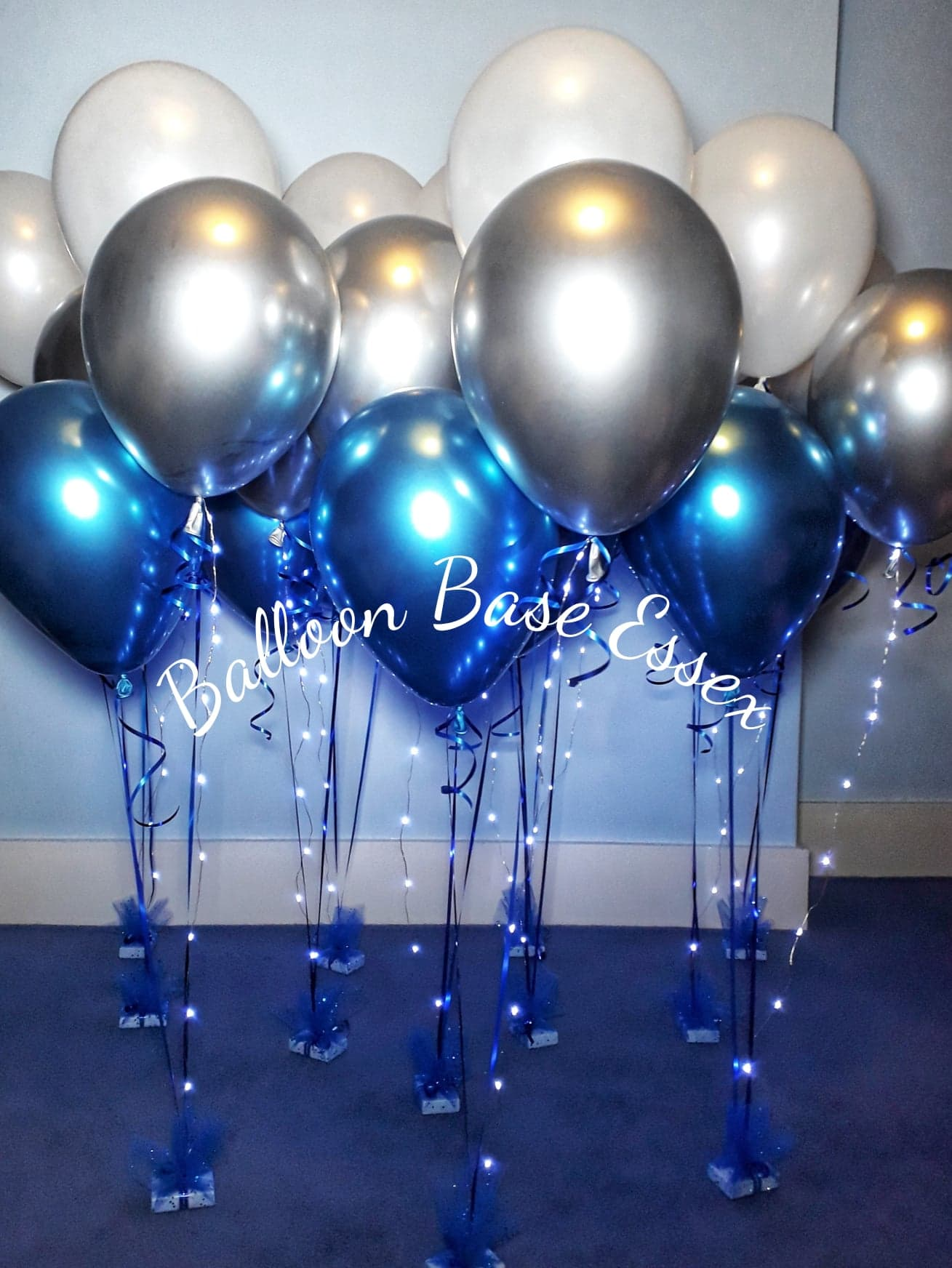 white blue and silver balloons with lights