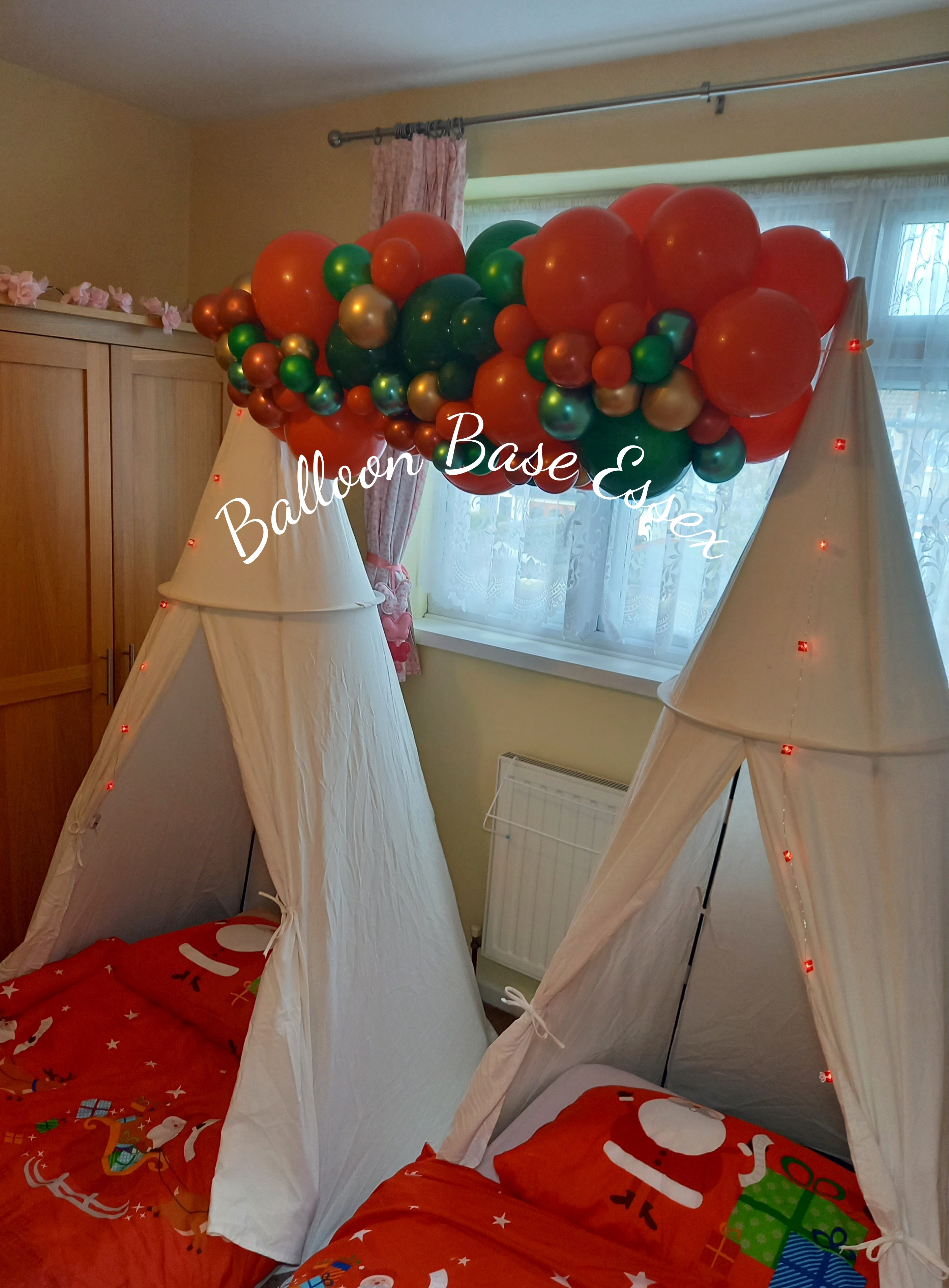 White tents with Chritmas balloon garland