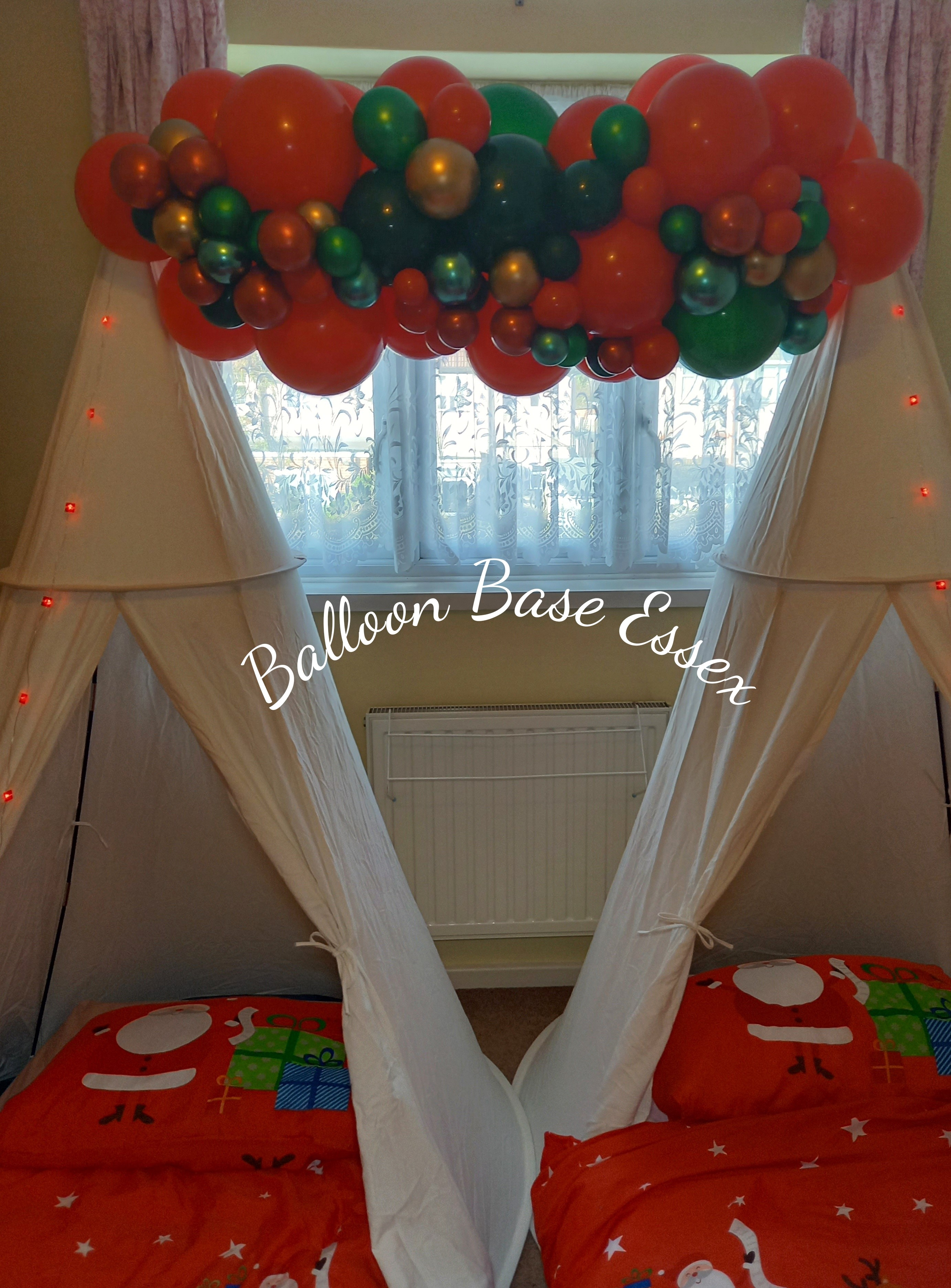 White teepee tents with balloon garland