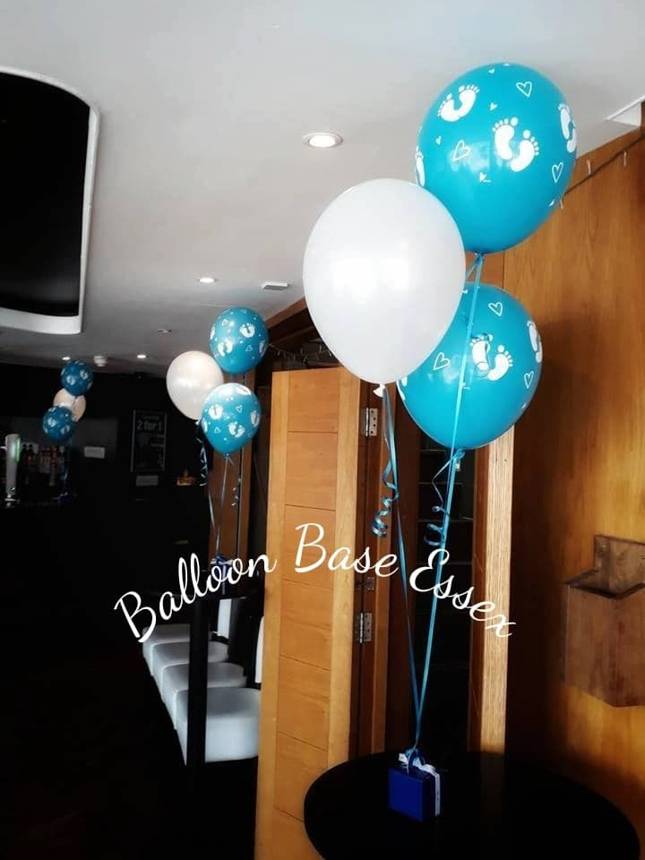 Baby shower balloons in blue and white